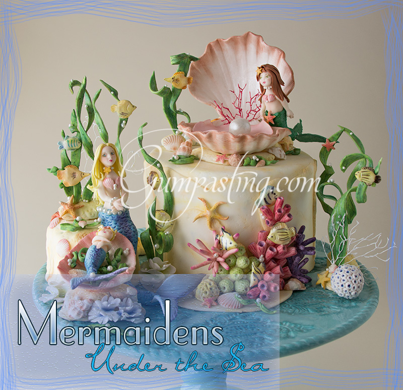 {A Diorama of Gumpaste Mermaidens Under the Sea with Fish, Shells and Coral}