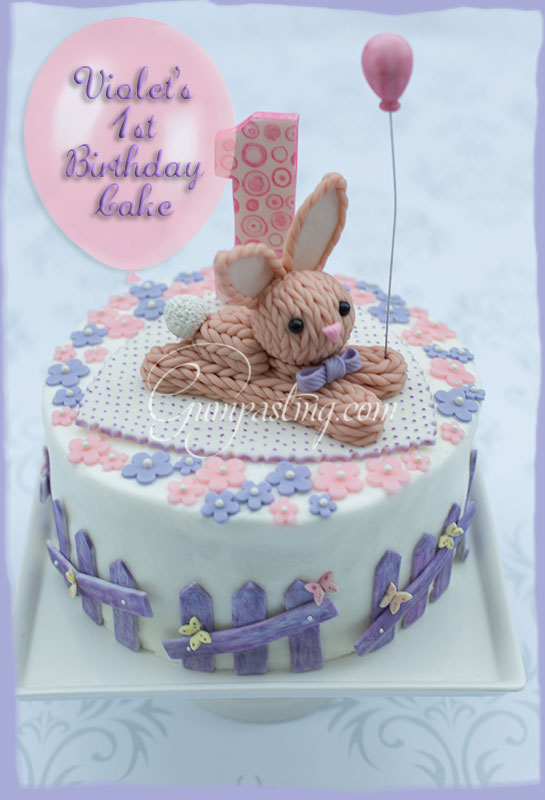 {A cute gumpaste/fondant knitted bunny topper for a Birthday cake}